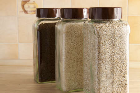 Grits and rice in jars photo