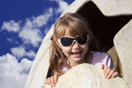 Girl in a dinosaur egg wearing sunglasses Stock Photo