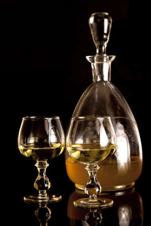 Old carafe with yellow vodka