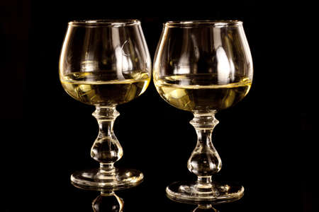Two glasses with honey vodka Stock Photo