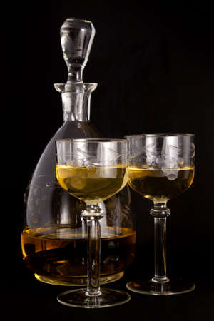 Honey vodka in a carafe and glasses Stock Photo