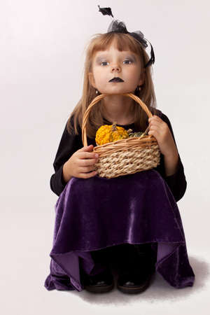 Painted girl with pumpkins for Halloween Stock Photo - 15754243