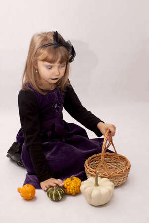 The girl in the purple dress with pumpkins Stock Photo