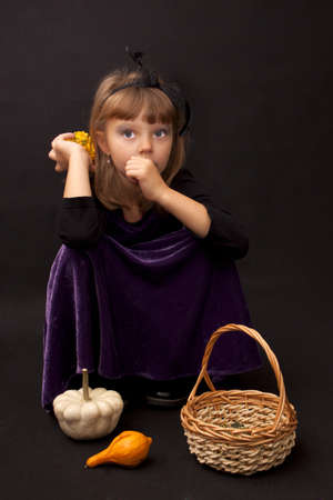 Preety girl with pumpkins on a black background Stock Photo - 15754245