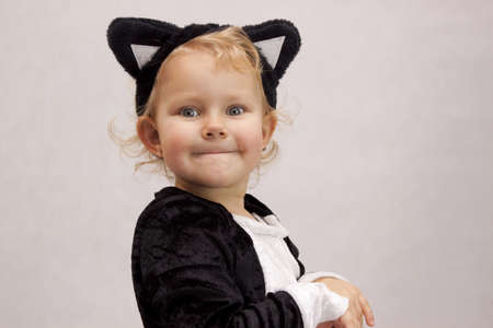 Child dressed as a cat on white background