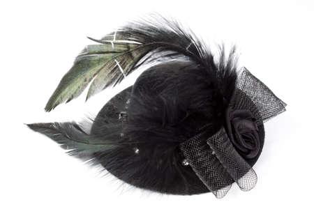 Black hat as a hairclip Stock Photo