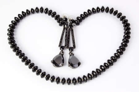 Earrings and necklace in the shape of heart