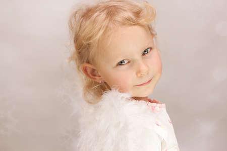 Little girl as sweet angel