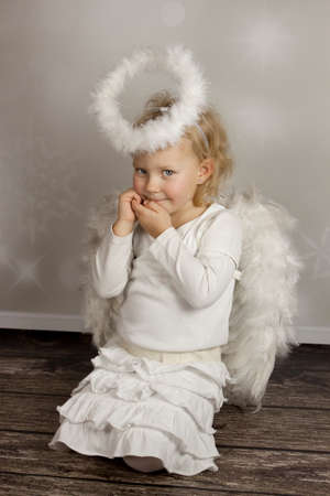 Pretty girl in angel s clothes Stock Photo