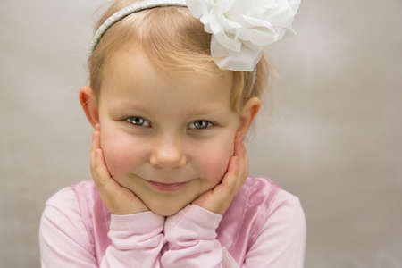 Small girl with white flower in head