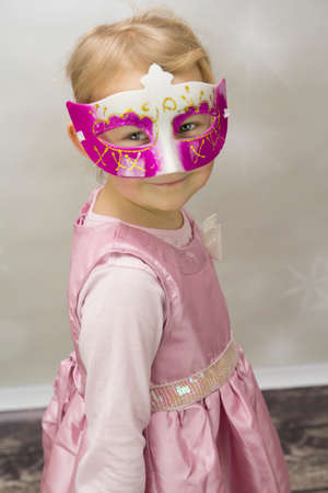 Small girl with mask on his face