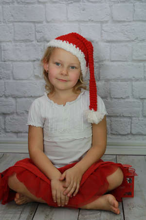 Beauty girl dressed as Santa Claus Stock Photo
