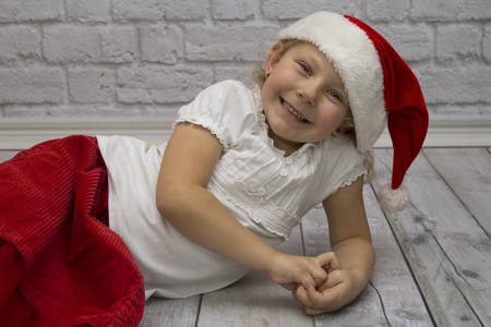 Christmas girl in red with santa hat Stock Photo