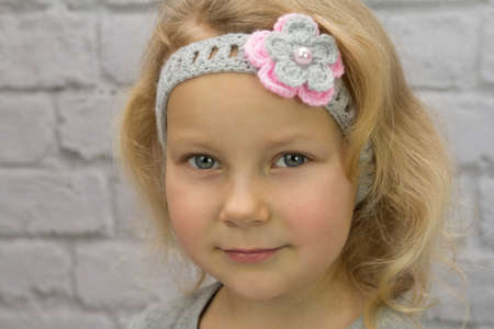 Little girl with a flower in her hair