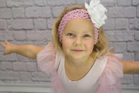 Lovely girl as a ballerina in a pink dress