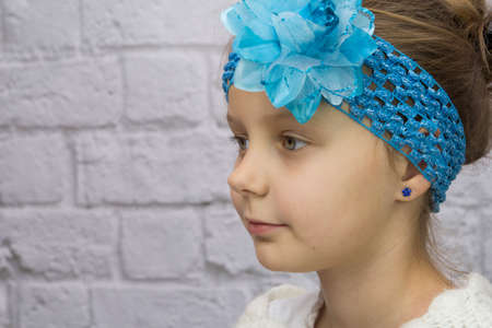 Girl with blue flower on her head Stock Photo