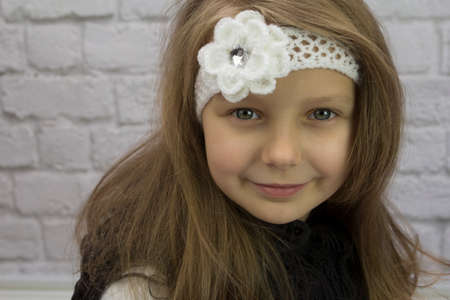 Beautiful girl with flower on her head Stock Photo