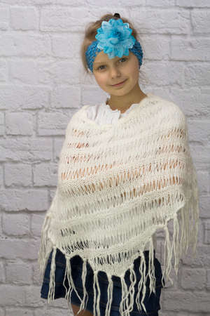 Girl with blue flower on her head and ponchos