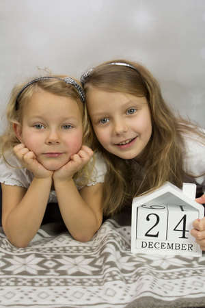 Christmas girls on a light background Stock Photo