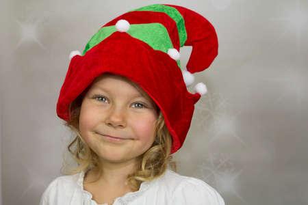 Girl in colorful hat elf