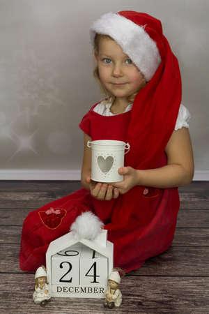 Girls as St. Santas Stock Photo