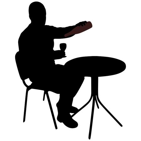 man sitting: young man sitting in a bar