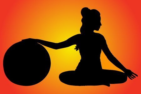 pilates ball: young woman doing pilates