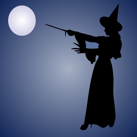 enchantress: Halloween Witch. Beautiful young woman in witches hat and costume holding magical wand in her hand