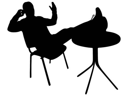 man relaxing with his feet up on the coffee table and talking on the phone