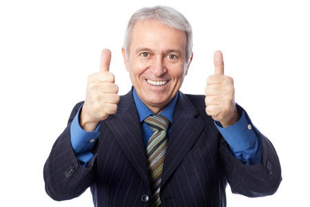 Image of senior businessman smiling and giving thumbs up, isolated on white