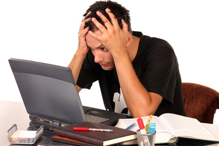Young man having trouble studying, on white background Standard-Bild