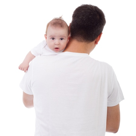 Cute Caucasian baby looking over father's shoulder, isolated on white