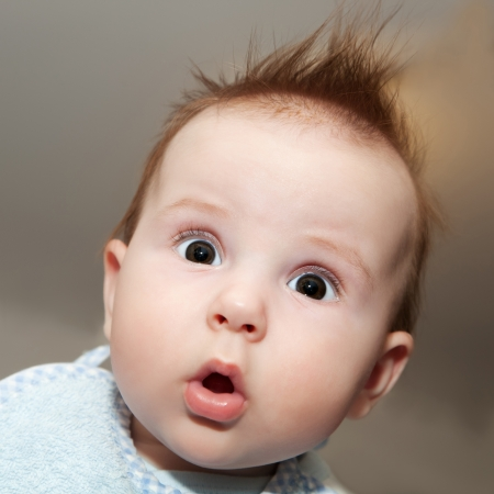 Cute 4 months old baby making a funny surprised face Banco de Imagens - 22123012