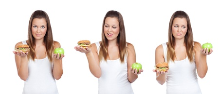 Triptych image of young woman having a dilemma: greasy hamburger or an apple? Isolated on white 免版税图像