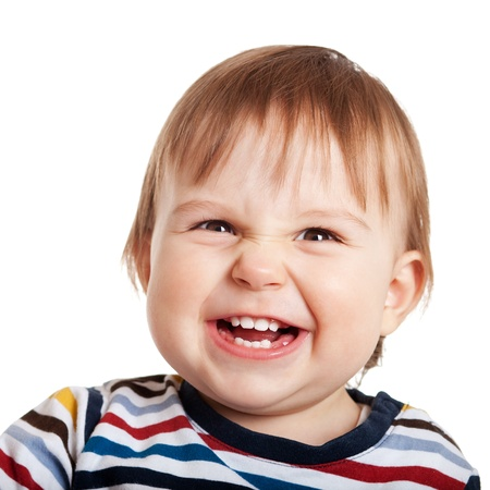 Close up of one year old child making a face, isolated on white