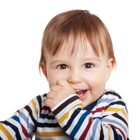 Close-up van schattig kind een jaar oud lachend, geïsoleerd op wit Stockfoto