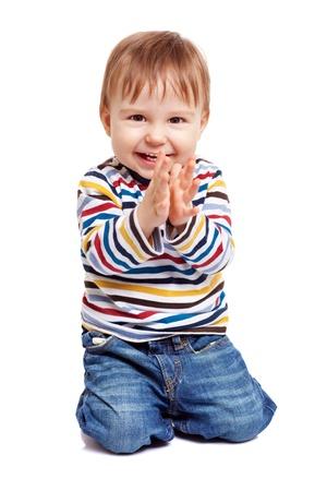 Adorable een jaar oude kind spelen met zijn grote teen en met een goede tijd, geïsoleerd op wit Stockfoto