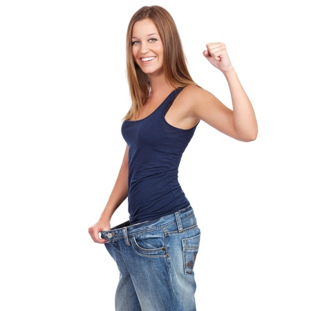 Young woman delighted with her dieting results, isolated on white 免版税图像