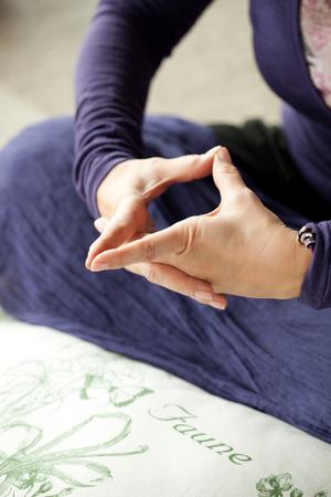 Woman holding uttarabodhi mudra hand position 免版税图像