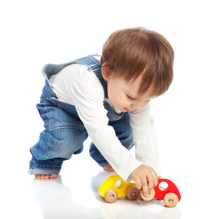 Adorable toddler playing with toy cars, isolated on white 免版税图像 - 39507757