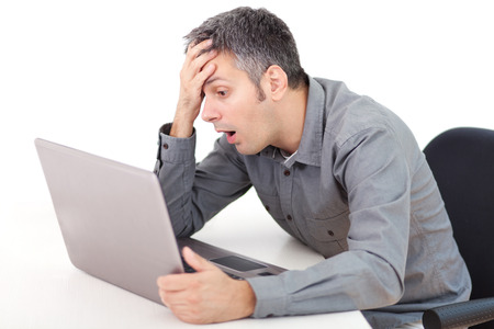 Young man having trouble with laptop Standard-Bild