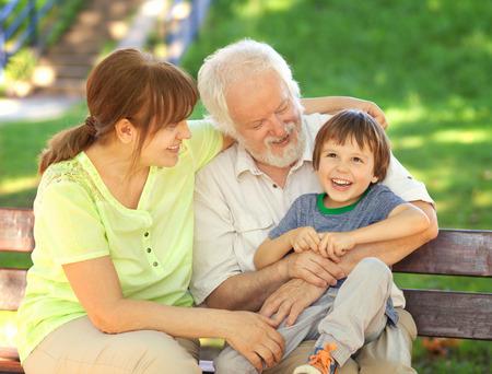 Grandparents having great fun with their grandchild 免版税图像