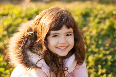 Portrait of beautiful girl outdoors, shallow depth of field
