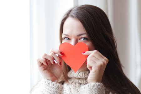 Image of woman holding heart symbol, shallow depth of field 免版税图像 - 51072064
