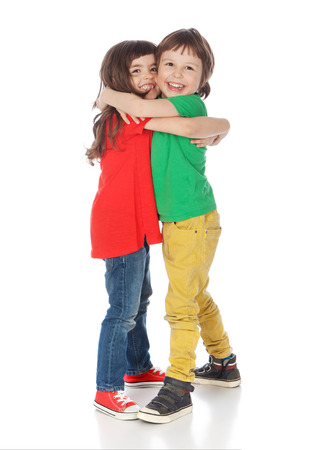 Adorable boy and girl hugging, isolated on white