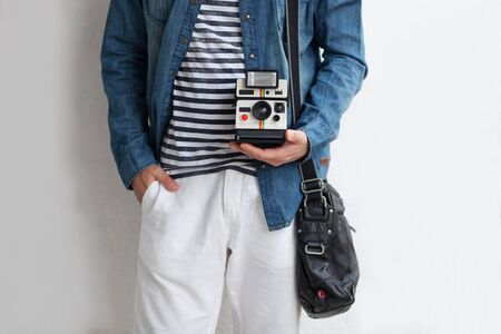 Image of young man holding instant camera 免版税图像