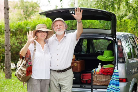 Senior couple arrive at holiday destination Stock fotó