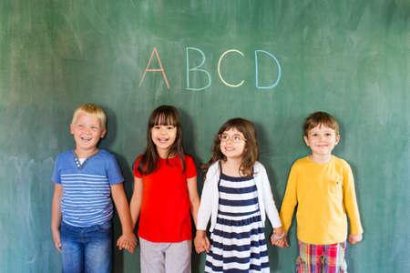 Image of adorable children holding hands 免版税图像 - 62300093