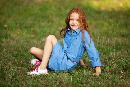 Close up portrait adorable little red-haired girl Stock Photo