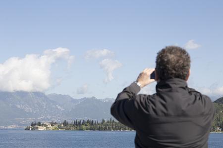 Man on deck of ferry lake of Garda Italy